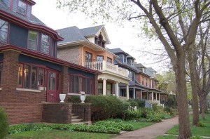 A view of Lakewood Avenue shows a row of homes with front porches, generous setbacks and sidewalks that lend to the neighborhood feel of the Lakewood Balmoral district.