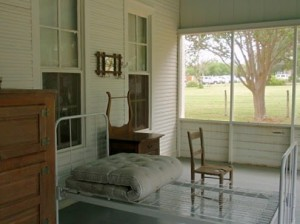 Heres a historically-staged sleeping porch.  Probably best not guess why the tuberculosis patients cot is rolled up.