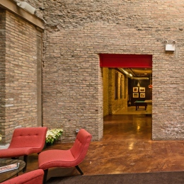 Chicago's former Dr Scholl's factory celebrates common brick in the interior.  Cool.